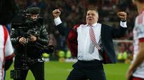 Sam Allardyce celebrates Sunderland's Premier League survival in style