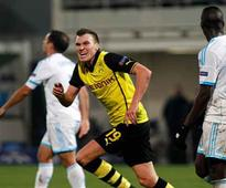 Dortmund, Milan advance in Champions League