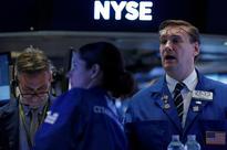 Wall Street - Strong earnings lift investor spirits after Trump slump