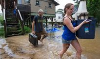 Floods kill at least 3 in southern US as heat wave bakes East Coast