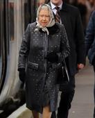 The Queen roughs it on commuter train back to London