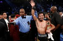 Pacquiao paid for gov't officials' trips to Vegas