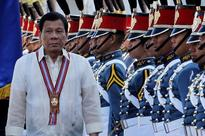 Wary of China, Duterte tells navy to build 'structures' east of Philippines