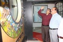 Dr. Harsh Vardhan reviews research activities at the Wadia Institute of Himalayan Geology