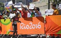 Sumgong wins women's Olympic marathon; protester removed