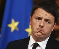 Renzi says won't send troops to Libya for now; freed Italian hostages fly home