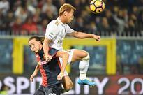 Genoa end 10-man Milan's bid for Serie A lead