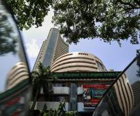 Equity indices trade flat-to-negative on weak global cues