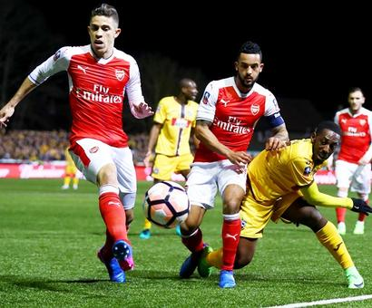 FA Cup: 100th goal for Walcott as Arsenal end Sutton's dream run