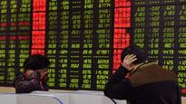 Wealth management curbs hit China stocks