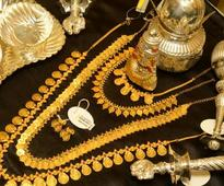Gold, silver tumble on stockist selling, weak demand