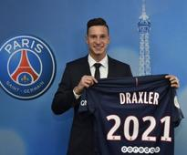Julian Draxler joins Ligue 1 champions PSG on a four-year deal from Wolfsburg
