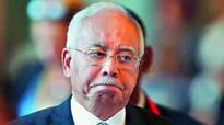 Malaysia govt backs expansion of Islamic law to amputation, stoning
