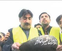 PTI ex-minister collecting alms for Peshawar development