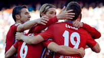 Atletico Madrid beat Granada to edge above Real Madrid in title challenge