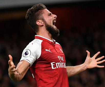 Giroud header seals Arsenal win in season-opening thriller