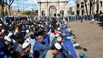 Muslims pray Friday prayers at Rome's Colosseeum