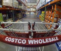 UPDATE 2-Costco's profit beats on fresh food sales, switch to Visa