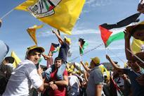 Palestine's Fatah votes in landmark internal polls