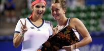 Sania Mirza and Barbora Strycova of Czech Republic pose with their victory trophy