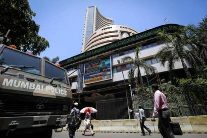 Markets slump further; Nifty below 7,000