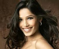 Freida Pinto looking at production