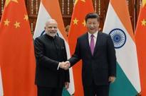 China sends warning to India, US