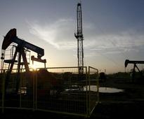 Oil up 2 percent as dollar softens; Brent in for big weekly loss