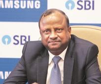 Moody's upgrade will make foreign funds cheaper: SBI Chief Rajnish Kumar