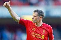 Liverpool's Carragher bows out on high