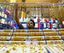Gold heads for best month in a year as US data disappoints