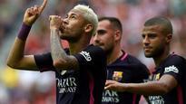 Suarez, Neymar fire Barca to massive win over Gijon