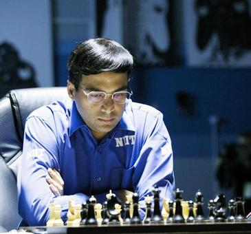 Anand draws with Wei Yi to stay in joint lead