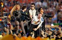 Harmony and friendship graced Super Bowl 50 halftime stage