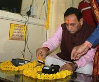 CM Vijay Rupani inaugurates cashless donation system in Ambaji temple by swiping card