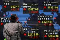 Asia stocks tepid, dollar near 14-year peak on Fed rally