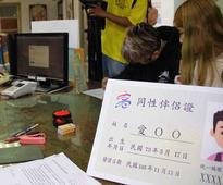 Kaohsiung issues nation's first 'partnership card' to two women