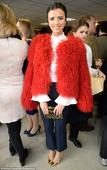 Lucy Mecklenburgh sizzles in an eye-catching shaggy red coat as she leads the style at The Hennessy Gold Cup