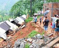 2 killed, 2 hurt in rain-induced wall collapse