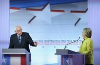 Clinton slams Sanders promises in debate