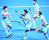 India romp into final