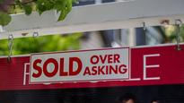 Who owns 29 per cent of Vancouver's luxury homes?