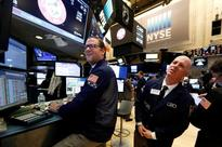 Wall Street record rally falters as banks, health stocks weigh