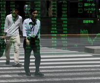 World stock markets climb on labour data, oil gains