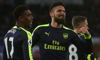 Arsenal canter to easy win as Swansea concede...