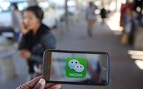 Apple teams up with China's WeChat to accept payments