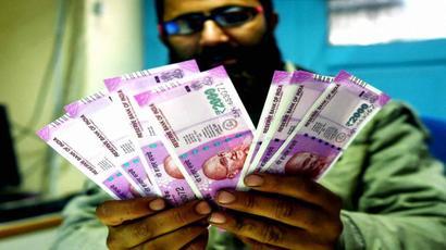 Indian rupee opens weak at 64.11 per dollar