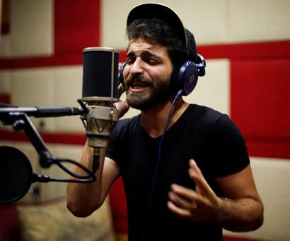 Why is this rapper from Gaza singing songs of unemployment?