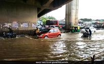 Boats out on streets as rain lashes Bengaluru