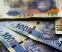 Rand firms as SARB holds rate
